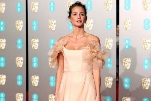 Choose romantic ruffles - Millie Mackintosh in frothy pink at the Baftas. Picture: Jonathan Brady/PA