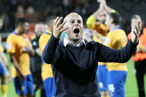 Mansfield manager Adam Murray celebrates the win at local rivals Notts County - Pic by: Richard Parkes