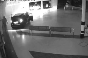 A still from the CCTV footage showing the thieves parked up in the shopping centre.