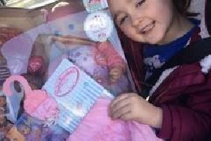 Amelia Cook, 4, with her new Annabelle toy.