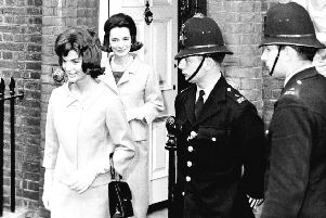 Jacqueline Kennedy is followed by her sister, Lee Radziwill, in London in 1961.