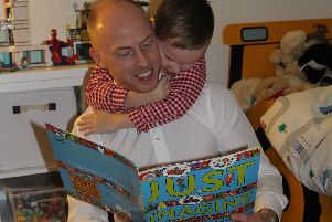 Teddy McGinley reads with his dad