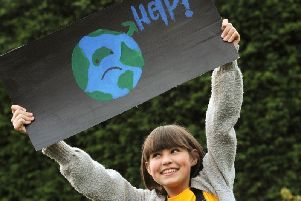 Poppy Asher, 12, with her climate change sign.