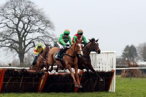 """Ms Parfois (left) ridden by Aidan Coleman jumps with Al Reesha ridden by Harry Skelton on their way to victory in the 188bet.co.uk EBF Mares� """"National Hunt"""" Novices� Hurdle at Warwick. Picture: David Davies/PA."""