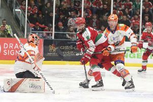 Davey Phillips tries to defend the Steelers' net at Cardiff Devils earlier this season. Picture: Helen Brabon/EIHL.