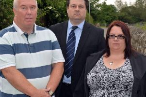 The family of Phil Dawn and councillors are campagining for a bridge over the level crossing near Kings Mill reservoir. Pictured are John Dawn, Coun Darren Langton and Phil's sister Tracy Hart.