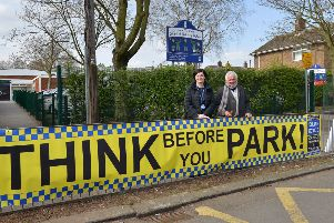 John T Rice Infant and Nursery School are erecting signs outside the school reminding people to park carefully, headteacher Shelley Bennett is pictured with Coun Sid Walker