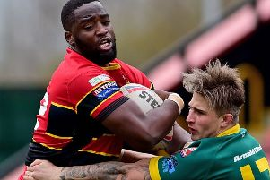 Dewsbury Sammy Kibula has a run halted by a West Hull defender during last Sunday's Coral Challenge Cup third round tie. Pictures: Paul Butterfield