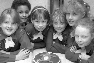 1989: These smiley Brownies from Skegby celebrate with cake at their 75th anniversary gala. Do you recognise anyone?