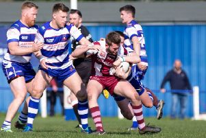 A Thornhill attacker sees his strong run halted during last Saturday's National Conference League Premier Division game at Siddal. Picture: Bruce Fitzgerald