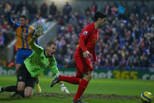 MANSFIELD, ENGLAND - JANUARY 06:  Luis Suarez of Liverpool goes around Alan Marriott of Mansfield Town to score during the FA Cup with Budweiser Third Round match between Mansfield Town and Liverpool at One Call Stadium on January 6, 2013 in Mansfield, England.  (Photo by Clive Mason/Getty Images)