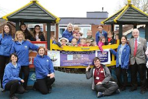 Dennis Skinner MP joins the staff and children at Woodhoots to celebrate their success