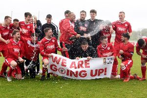 Longridge Town's players celebrate winning the title and claiming promotion following their win at the Mike Riding Ground
