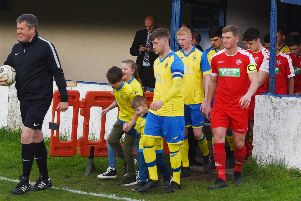 Ashton Town (red kits) v Ashton Athletic in this weeks Wigan Cup Final