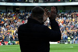 Mansfield Town v Milton Keynes.'David Flitcroft applauds the visiting fans at the start of the match.