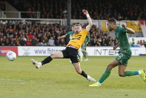 CJ Hamilton scores at Newport in the first leg.