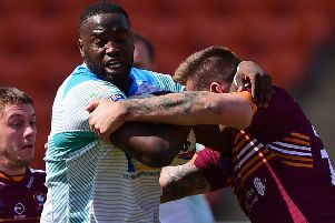 Dewsbury's Samy Kibula attempts to wrestle free from Toby Everett's tackle during last Sunday's Heavy Woollen derby at the Summer Bash in Blackpool. Picture: Paul Butterfield