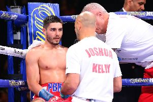 Josh Kelly with trainer Adam Booth during his majority draw with Ray Robinson (Matchroom).