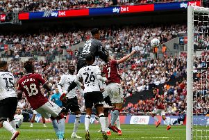 Roos in action during Derby's play-off final defeat.