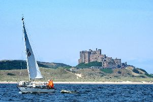 Sail on by......a yacht glides by Bamburgh Castle, taken by Jane Coltman while she was enjoying a trip to Longstone Lighthouse on the Golden Gate boat from Seahouses.