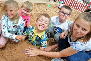 Alfie Whitehead lets his siblings and cousins plant him in the sand,from left, Brooklyn-Gray Whitehead,Harrison Hyatt, Braidon Whitehead,  and 12 year old Chardonnay Hyatt at last year's beach