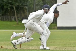 Kershaski John Lewis, who took 4-13 and then scored 63 not out off 46 balls, runs in watched closely by non-strike Hunslet Nelson batsman, Jack Scanlon. 'Carlton won by eight wickets and stay top of Championship 2. PIC: Steve Riding