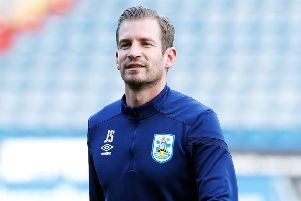 Taking it on the chin: But with just one win in 18 games, Huddersfield Town manager Jan Siewert is under increasing pressure at the John Smith's Stadium. (Picture: Martin Rickett/PA)