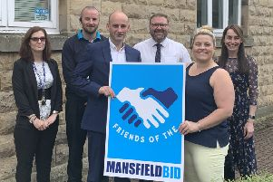 Director Dean Parrish enrols Churchside Insurance as a member of the Friends Of BID initiative. He is pictured with Nikki Rolls and Tom Wilson, of BID, and Churchside employees Sian-Ann Pestell, Damian Booker and Emily Boler.