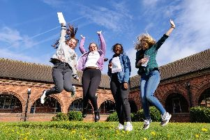 Students jump for joy at their results.