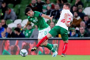 Captain's honour: Sheffield United's John Egan, left, wore the armband for the Republic of Ireland against Bulgaria on Tuesday night. (Picture: PA)