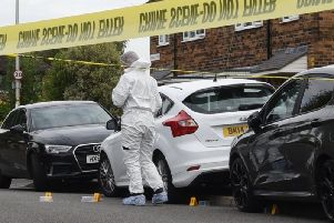 Forensics comb the scene in Vicarage Road