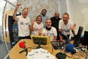 Radio Leyland staff celebrate the launch of the station
