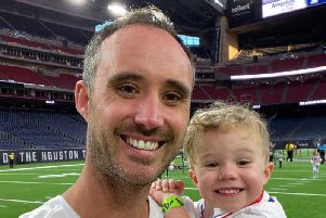 Two-year-old Jaxon Callon, pictured with his dad Ben, of Hoghton, has completed a 1km run in America in support of St Catherines Hospice