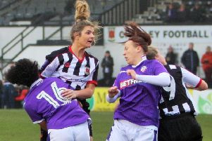 Michelle Saunders rises high to power a head towards the Bolton goal
