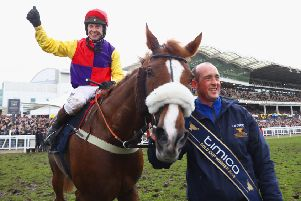 Thumbs up from champion jockey Richard Johnson after Native River's stirring victory in last season's Cheltenham Gold Cup. (PHOTO BY: Michael Steele/Getty Images).