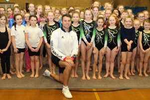 Olympic gymnast Kristian Thomas with youngsters from primary schools across High Peak at an afternoon of activities at New Mills Lesiure Centre