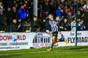 Marcus Carver celebrates after scoring against Brackley. Photo credit: Stefan Willoughby