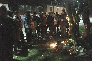 Scores of family and friends gathered on Wigan Road to pay their respects to Jordan