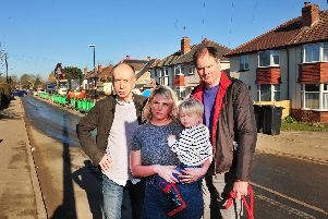 Residents annoyed at road closures caused by current house building in the Kingsley Road area of Harrogate: John Hansard, Victoria Newsome with her son Billy and Tim Redshaw. (Picture by Gerard Binks)