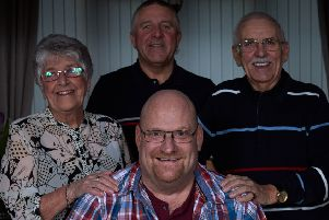 Fred Day, right, with his neighbour David Bell, front, wife Ann and son David.