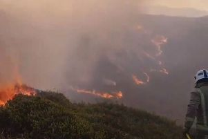 Britain's heatwave sees firefighters battle to fight large fire 0 this one on Ilkley Moor in Yorkshire.