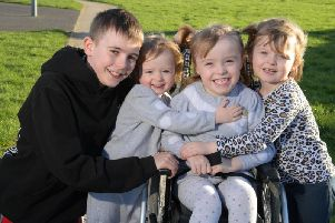 Caidi Gregson, 4, has cerebal palsy and hopes to raise 16,000 for an operation, pictured with Cian, Connie-Jayne and cousin Kylie