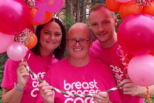 Vicki Lea with her twins Adam and Jessica, who raised 3,020 for Breast Cancer Care by holding an afternoon tea party