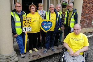 Protect Chorley Hospital campaigners gather outside a meeting about the future of the hospital