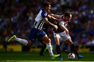Brighton skipper Lewis Dunk didn't give striker Ashley Barnes an inch at the Amex Stadium