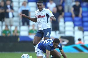 Preston right-back Darnell Fisher leaves Jude Bellingham on the floor
