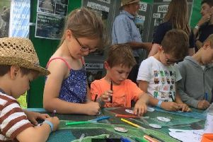 Badge making on the Ribble Rivers Trust stand at Goosnargh and Longridge show