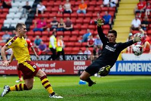 Sam Vokes of Burnley scores his team's first goal past Nick Pope of Charlton Athletic during the Championship match on May 7, 2016