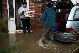 The British Red Cross has released 50,000 to help people across parts of the Midlands and South Yorkshire hit by devastating floods last week.