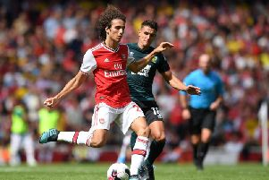 Matteo Guendouzi of Arsenal is tackled by Ashley Westwood of Burnley during the Premier League match between Arsenal FC and Burnley FC at Emirates Stadium